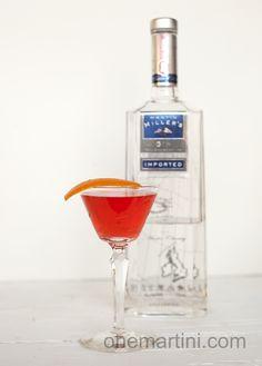 Blushing Beauty: 1½ ounces Martin Miller Gin ¾ ounce Campari ¼ ounce Ventura blood orange orangecello Orange peel for garnish