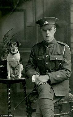 Corporal of the Worcestershire Regiment is pictured with his dog in 1917
