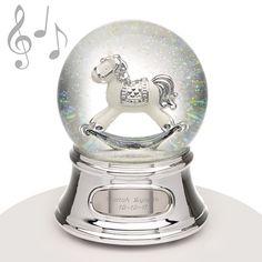 "Musical Water Globe - Rocking Horse - Perfect for a new baby! This water globe features a white rocking horse with silver accents and makes the perfect gift for any little one in your life. The music that plays is ""Brahm's Lullaby."""