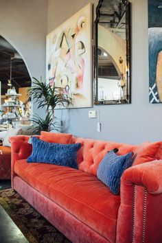 A red velvet couch to add a pop of color and a little spunk to your living room found at Avery Lane in Scottsdale, Arizona