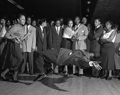 Defying gravity in 1953 Lindy contest at Harlem's Savoy Ballroom, from the AP exhibit.