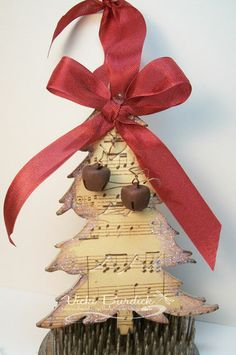 Christmas Tree Ornament made from Music Paper, chipboard, glitter & decorations/ribbon you have on hand.