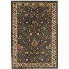 #traditionalrug #accentrug #arearug #jaipur Poeme Biarritz Rug from Jaipur - PM61 This traditional asian style accent rug from jaipur rugs is hand tufted from 100% wool and finished in a deep blue gray, olive & dark ivory color. In-stock rugs usually ship in 3 to 5 days. $83.00