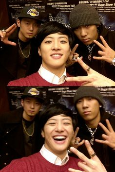 Big Star's FeelDog takes a photo with rappers The Quiett and Dok2