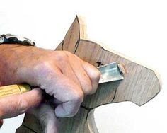 Using as big a gouge as you can handle, cut down each side of the nose to the lines you have drawn...