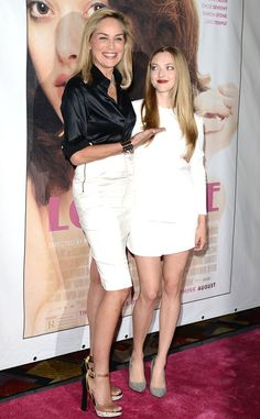 The actresses attend the Lovelace premiere in Las Vegas in two white-hot ensembles: Stone dons a black button-down and sleek pencil skirt with chunky, color-blocked sandals, while Seyfried goes for white-on-white in a Stella McCartney skirt and top combo paired with gray-suede Calvin Klein Collection pumps.