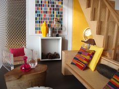This modern room looks great! Lots of splashes of color.