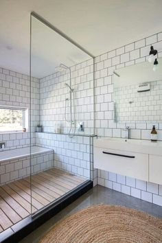 60 Elegant Small Master Bathroom Remodel Ideas, modern bathroom with offset white tile and walk in tile shower, neutral modern bathroom, black and white bathroom design, bathtub inside shower Bathroom Renos, Laundry In Bathroom, Bathroom Interior, Modern Bathroom, Bathroom Ideas, Bathroom Remodeling, White Bathroom, Modern Shower, Bathroom Cabinets