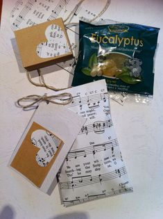 Envelopes out of old songbook and some yummy honey and eucalyptus lollies inside cant wait to give these out !!!