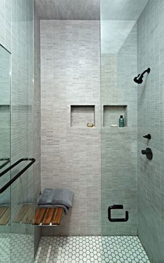 Recesses in a shower for toiletries - much nicer than a metal basket