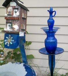 all-blue totem next to recycled satellite dish.