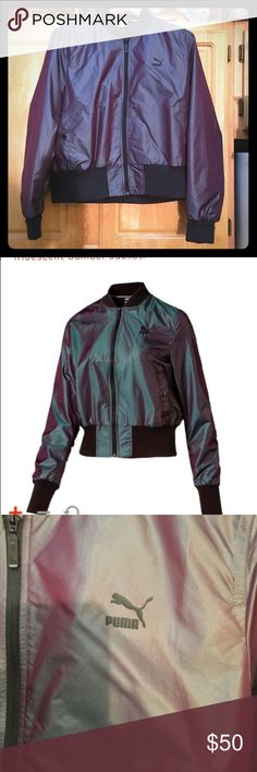 """PUMA iridescent bomber jacket- sz. XL PUMA Iridescent bomber jacket, size XL. Style #: 572520-48. Color:purple. Very fitted. Puma size chart listed; however, I'm a size 12/L in tops; 38D bra size. (See pictures). My measurements taken: 21.5"""" armpit to armpit, and 20.5"""" shoulder to hem. Matching shoes listed in closet as well! Puma Jackets & Coats"""