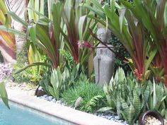 Florida Tropical Bali/Moroccan Oasis: Statue purchased from an import store in Miami.  It is from Bali and made from volcanic rock.  I thi