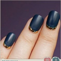 Flat black and gold nails