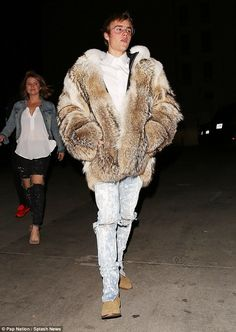 Hard to miss: Justin Bieber sported a thick fur coat for an appearance in Los Angeles as h...