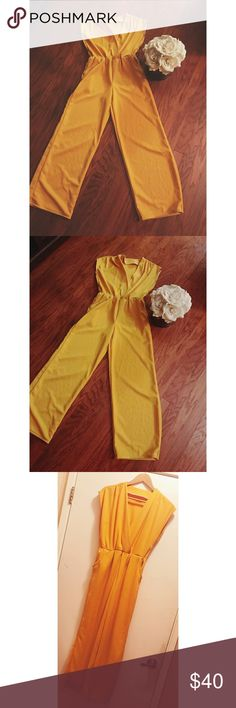 Vintage 1950's-60's Yellow Poly JumpSuit!!!! Vintage 1950's-1960's Yellow Poly JumpSuit . Two side pockets V cut neckline , elastic waistband . Jump into this JumpSuit if you want to feel retro and fashionable ! Size Medium Pants Jumpsuits & Rompers