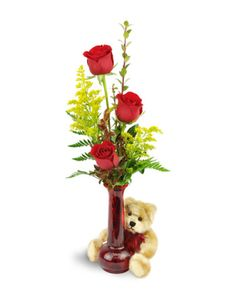 Simple, elegant, and the perfect way to send your love on Valentine's Day! Deep red roses are the ideal expression of romance and beauty, and an adorable plush bear adds a touch of delight for your special girl!   Three stunning red roses are arranged with solidago in a red bud vase, with an adorable plush teddy bear included!