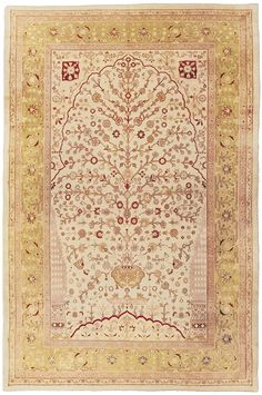 "A delicately rendered depiction of the ""Tree of Life"" or ""World Tree,"" a inspiring symbol in virtually every culture is the focal point of this exquisite, wonderfully understated antique Agra Oriental carpet."