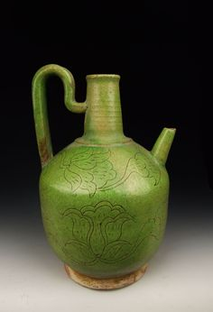 Liao Dynasty, Green Glaze Pottery Wine Pot, with incised pattern.