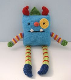 This PDF Knitting pattern will instruct you on how to knit my original Monster Amigurumi Pattern. I have included photos of the assembly to help you along. Finished Monster measures 15 inches tall. Materials: Worsted weight yarn 1 pair of size 4 knitting needles Stuffing Safety eyes- 1