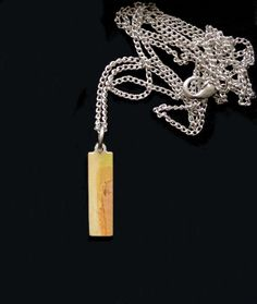 """Rectangular Pendant Necklace #street #Streetstyle #jewellery #Necklace #unisex MinimalistRectangular shaped Pendant. Tones and Shades of beige, yellow, green and terracotta. Good for layering or on its own. A Nice supplement toYour Everyday Wear. Original Art Motive printed on Brass,Metal. The Necklace is plated with Silver. Pendant Rectangle: 2.222cmx0.635cm/Inches7/8"""" long1/4"""" wide. Comes with a 30 inches/76.2 cm long Chain, orchoose chain Option 16 Inches/40.64cm. Shades Of Beige, Brass Metal, Terracotta, Fashion Art, Layering, Original Art, Plating, Street Style, Pendant Necklace"""
