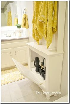 7 Creative Storage Solutions to Curb the Clutter- love this hair tool storage cabinet idea! Home, Hair Tool Storage, Creative Storage Solutions, Storage Cabinet, Bathroom Storage, Towel Rack, Tool Storage Cabinets, Storage, Bathroom Decor