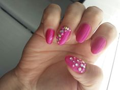Acrylic nails with pink gel polish, rhinestones and faux pearls. Allure nails. February 2012