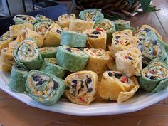 mexican pinwheels - but I add 4 oz sour cream to mixture, and leave out green onions, add a little more shredded cheese to mixture, and have a few extra tortillas on hand.  and of course, have salsa to dip