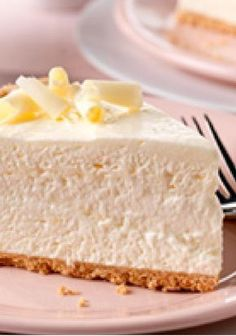 Fluffy White Chocolate Cheesecake — A filling of cream cheese, white chocolate flavor pudding and whipped topping is spooned into a graham cracker crust in this airy, no-bake dessert.