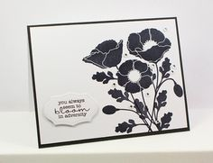 handmade card ... black and white ... flowers stamped  in black ... die cut label with sentiment ... clean and elegant look with crisp stamping ...