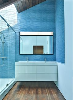 Blue tiles reflect daylight on the dark wooden floors and ceiling frame. Martin Fenlon Architecture is a Los Angeles-based firm that's committed to seeking sustainable architecture in innovative spaces. Bathroom Photos, Budget Bathroom, Bathroom Renovations, Bathroom Interior, Small Bathroom, Bathroom Ideas, Bathroom Designs, Ocean Bathroom, Minimal Bathroom