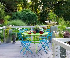 Many mixed-material decks use multiple colors as part of their design. But if your deck furniture already exhibits its own colorful exuberance, you may want to tone down your deck railings so that they serve more as backdrop than focal point. This outdoor space, with railings made from man-made materials and wire, acts as supporting cast member to the creative collection of bright furniture, sculptural containers, and distinctive plants.