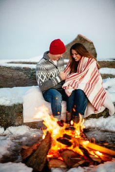 Cozying up by the fire: http://www.stylemepretty.com/illinois-weddings/2013/12/23/winter-engagement-session/ | Photography: Love is a Big Deal - http://www.loveisabigdeal.com/