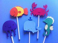 12 under the sea theme cupcake toppers, crab, seahorse, jellyfish, whale, goldfish, kids party, baby shower. $8.49, via Etsy.