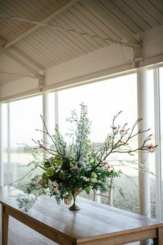 Beautiful rustic style wedding table centrepiece, by Myrtle and Bracken florist (the bride!).  From 'The Florist and The Fiddler ~ A Floral and Musical Inspired Wedding at Crear in Scotland'  Photography by http://www.caroweiss.com/