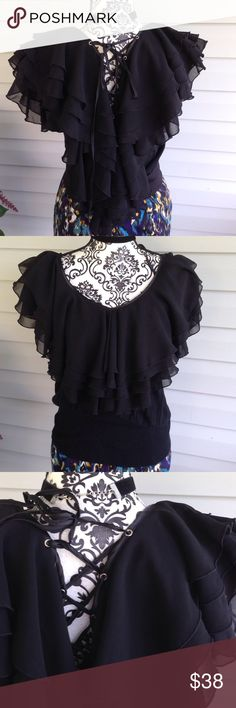 Stunning Fluffy Ruffle Black Lace Up Boho Blouse Tons & tons of light, chiffon ruffles. Lace up back. Deep V cut. Quality QUALITY fabric. Lightweight sweater material makes up the rest of the blouse. Size small but it has a bit of stretch to it. I wore it when I was a size large very comfortably. Stunning, stunning, stunning!!!! Boho. Peasant/Victorian!! Topin Tops Blouses