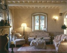 Soft colors, textures and patterns. Beautiful fireplace. Beams and window shape. Faux painting on lower part of the walls.