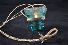 Rustic Insulators with string and add a battery operated votive to hand outside.