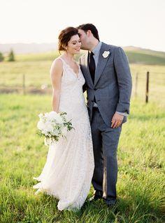pretty dress , gorg flowers and nice field ...Romantic Wedding in Napa - beautiful wedding, love her dress.