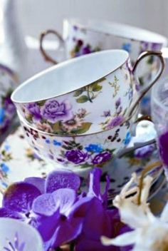 purple and white china with purple flowers