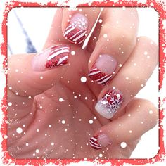 Christmas gel nails with snowflakes, candy canes and red glitter
