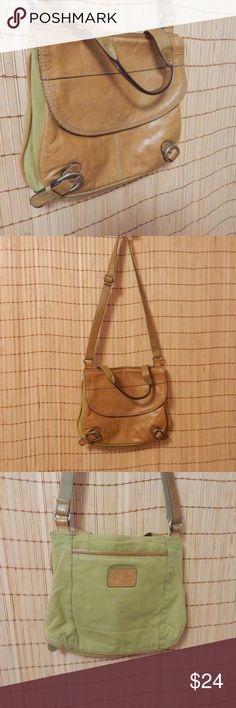 """Vintage Fossil Crossbody This is a real vintage distressed fossil crossbody/satchel. #zb2671 This is not part of the """"Long Live Vintage"""" line. A little discolored but very comfy. The leather is very supple. Nice size. The fossil key charm is missing. Fossil Bags Crossbody Bags"""