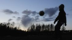 A child plays football in a park in Vaasa, Finland, 16 April 16 2010