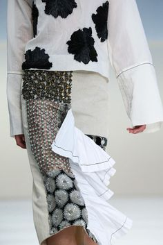 Patchwork embellishment, textured flower applique & ruffle panel; juxtaposing fashion details // Marni Spring 2015