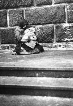 Warsaw, Poland, a woman with a baby in the ghetto street, early 1941.