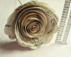 These dictionary or book page paper flowers add an elegant & unique touch any centerpiece, or bouquet. And even make stunning cake decorations. You can use these vintage inspired paper flowers to decorate the shelf that your wedding pictures sit on, or any shelf or table for that matter to add a sweet, shabby chic touch to any room.    Each rose measures approximately 1.5 – 2 inches and comes with a stem 12 inch stem made of thick, 18 gauge green floral wire. They are crafted out of either…