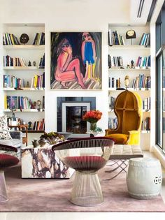 I spy 3 different designer chairs in one room.