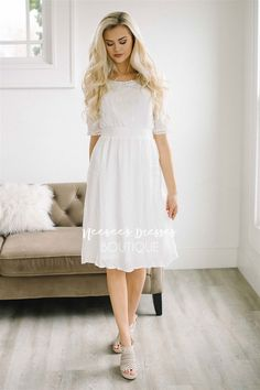 All of the details are just too cute and it's the perfect dress for spring and summer outings. Ivory textured dress features a wide stretch waistband, crochet lace details around the neckline and arms, and beautiful cream embroidery on the sleeves.
