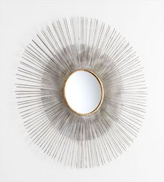 Pixley Mirror is available in. Round shape and protruding iron spikes are accented with luxe gold ring around mirror inset.