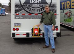 Carl Boettcher of HTS Systems displays the new HTS-CC-18V vertical mount Cone Cradle opens to 90° degrees, an excellent safety application for side-loader beverage trucks. Deploy and stow traffic safety cones in just seconds! Create a safe work perimeter when making deliveries safely, quickly and easily.